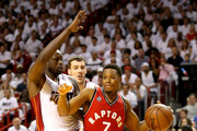 Kyle Lowry #7 of the Toronto Raptors drives to the basket against Luol Deng #9 of the Miami Heat during Game 6 of the Eastern Conference Semifinals of the 2016 NBA Playoffs at American Airlines Arena on May 13, 2016 in Miami, Florida. NOTE TO USER: User expressly acknowledges and agrees that, by downloading and or using this photograph, User is consenting to the terms and conditions of the Getty Images License Agreement.