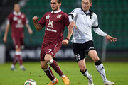 Diniyar Bilyaletdinov (R) of FC Torpedo Moscow is challenged by Magomed Ozdoev of FC Rubin Kazan during the Russian Premier League match between FC Torpedo Moscow and FC Rubin Kazan at the Eduard Streltsov Stadium on May 03, 2015 in Moscow, Russia.