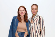 Julianne Moore (L) and Adwoa Aboah attend the Tory Burch Fall Winter 2020 Fashion Show at Sotheby's on February 09, 2020 in New York City.