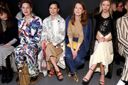 (L-R) Francesca DiMattio, Lucy Liu, Julianne Moore, and Mia Goth attend the Tory Burch Fall Winter 2020 Fashion Show at Sotheby's on February 09, 2020 in New York City.