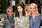 (L-R) Halima Aden, Alexandra Daddario, and Charlotte Lawrence attend Tory Burch NYFW SS20 at the Brooklyn Museum on September 08, 2019 in Brooklyn City.