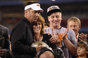 Head coach Mike Gundy of the Oklahoma State Cowboys hugs Shelly Budke on stage after Oklahoma State Cowboys won 41-38 in overtime against the Stanford Cardinal during the Tostitos Fiesta Bowl on January 2, 2012 at University of Phoenix Stadium in Glendale, Arizona.
