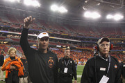 Head coach Mike Gundy of the Oklahoma State Cowboys walks off of the field after Oklahoma State Cowboys won 41-38 against the Stanford Cardinal during the Tostitos Fiesta Bowl on January 2, 2012 at University of Phoenix Stadium in Glendale, Arizona.