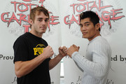 Michael 'Tomahawk' Thompson of Australia and Ghot Seur Noi of Thailand pose for a photograph after the Total Carnage IV press conference at Gold Coast Volkswagen on December 11, 2013 on the Gold Coast, Australia.