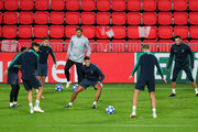 Harry Winks of Tottenham Hotspur, Erik Lamela of Tottenham Hotspur, and Eric Dier of Tottenham Hotspur take part in a drill during a training session ahead of their UEFA Champions League Group B match against PSV at Philips Stadion on October 23, 2018 in Eindhoven, Netherlands.