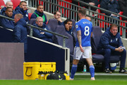 Joe Ralls of Cardiff City walks off the pitch after being sent off by match referee Mike Dean during the Premier League match between Tottenham Hotspur and Cardiff City at Tottenham Hotspur Stadium on October 6, 2018 in London, United Kingdom.