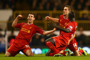 Jordan Henderson of Liverpool celebrates scoring their second goal with Jon Flanagan (L) and Mamadou Sakho of Liverpool (R) during the Barclays Premier League match between Tottenham Hotspur and Liverpool at White Hart Lane on December 15, 2013 in London, England.