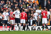 Referee Mike Dean shows a yellow card to Memphis Depay of Manchester United (7) during the Barclays Premier League match between Tottenham Hotspur and Manchester United at White Hart Lane on April 10, 2016 in London, England.