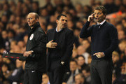 Tim Sherwood (R), manager of Tottenham Hotspur gives instructions with Gus Poyet (C), manager of Sunderland and fourth official Mike Dean during the Barclays Premier League match between Tottenham Hotspur and Sunderland at White Hart Lane on April 7, 2014 in London, England.