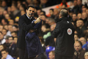 Gus Poyet, manager of Sunderland exchanges words with fourth official Mike Dean during the Barclays Premier League match between Tottenham Hotspur and Sunderland at White Hart Lane on April 7, 2014 in London, England.