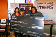 (L-R) Regina Borda of Taco Bell for Foundation for Teens, $10,000 scholarship winner Bria Gregory, Detroit Lions running back Reggie Bush and Bria's mother attend the Touchdown For Teens Campaign at Taco Bell on August 26, 2014 in Royal Oak, Michigan.