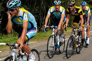 Alberto Contador (L) of Spain and team Astana talks on his mobile phone as his teammate Lance Armstrong of USA (2nd R) smiles while talking with Dmitriy Muravyev of Kazakhstann (C) during a training session on the first rest day of the 2009 Tour de France on July 13, 2009 in Limoges, France.