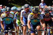 Lance Armstrong (2nd R) of USA and team Astana climbs flanked by his teammate Alberto Contador (L) of Spain and Cadel Evans (R) of Australia and team Silence Lotto up the Col d'Agnes during stage eight of the 2009 Tour de France from Andorra la Vella to St Girons on July 11, 2009 on Col d'Agnes, France.