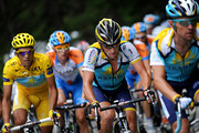 Lance Armstrong (R) of USA and team Astana climbs up the Col du Petit-Saint-Bernard flanked by his teammate and race leader Alberto Contador of Spain in the yellow jersey during stage 16 of the 2009 Tour de France from Martigny to Bourg-Saint-Maurice on July 21, 2009 on Col du Petit-Saint-Bernard, Italy.