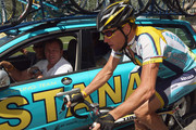 Lance Armstrong of the USA and Astana talks to team Manager Johan Bruyneel on stage 20 of the 2009 Tour de France from Montelimar to Mont Ventoux on July 25, 2009 on Mont Ventoux, France.