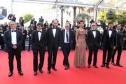 """(R-L) Guest, Pierfrancesco Favino, guest, Maria Fernanda Candido, Marco Bellocchio, Fausto Russo Alesi, Luigi Lo Cascio and guest attend the screening of """"The Traitor"""" during the 72nd annual Cannes Film Festival on May 23, 2019 in Cannes, France."""
