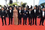 """(L-R) Guest, Pierfrancesco Favino, Maria Fernanda Candido, guest, Marco Bellocchio, Luigi Lo Cascio, Fausto Russo Alesi, and guest attend the screening of """"The Traitor"""" during the 72nd annual Cannes Film Festival on May 23, 2019 in Cannes, France."""