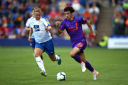 Curtis Jones of Liverpool battles with Jay Harris of Tranmere Rovers during the Pre-Season Friendly match between Tranmere Rovers and Liverpool at Prenton Park on July 11, 2018 in Birkenhead, England.