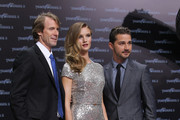 "Director Michael Bay, actress Rosie Huntington-Whiteley and actor Shia LaBeouf attend the ""Transformers 3"" European premiere on June 25, 2011 in Berlin, Germany."