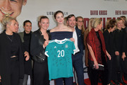 """Alexandra Popp of Germany women's soccer team, actress Freya Mavor, David Kross  and Germany women's soccer team during the premiere of the film """"Trautmann"""" at Mathaeser Filmpalast on March 4, 2019 in Munich, Germany."""