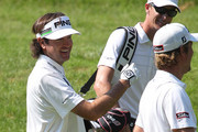 Bubba Watson reacts his caddie and with Webb Simpson after Watson hit eagle on the 10th hole during Round One of the 2012 Travelers Championship at TPC River Highlands on June 21, 2012 in Cromwell, Connecticut.