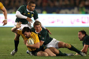 Adam Ashley-Cooper of the Wallabies is tackled by Bryan Habana and Jean de Villiers (R) during the 2010 Tri-Nations match between the South African Springboks and the Australian Wallabies at Loftus Versfeld on August 28, 2010 in Pretoria, South Africa.