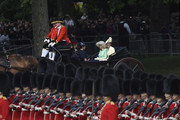 Camilla, Duchess of Cornwall, Catherine, Duchess of Cambridge, Prince Harry, Duke of Sussex and Meghan, Duchess of Sussex arrive in a horse drawn carriage in Horseguards Parade for Trooping the Colour, the Queen's annual birthday parade, on June 08, 2019 in London, England.