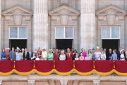 (L-R) Albert Windsor, Britain's Prince William, Duke of Cambridge holding Prince Louis, Prince George, Princess Charlotte, Britain's Catherine, Duchess of Cambridge, Britain's Camilla, Duchess of Cornwall, Vice Admiral Timothy Laurence, Britain's Prince Charles, Prince of Wales, Britain's Princess Beatrice of York, Britain's Princess Anne, Princess Royal,, Britain's Queen Elizabeth II, Britain's Princess Eugenie of York, Britain's Lady Louise Windsor, Britain's Prince Andrew, Duke of York,, Britain's Prince Harry, Duke of Sussex, Britain's Meghan, Duchess of Sussex, Isla Phillips, James, Viscount Severn, Savannah Phillips, Peter Phillips, Autumn Phillips, Lyla Gilman, Eloise Taylor and Britain's Lady Helen Taylor stand with other members of the Royal Family on the balcony of Buckingham Palace to watch a fly-past of aircraft by the Royal Air Force during Trooping The Colour, the Queen's annual birthday parade, on June 08, 2019 in London, England.