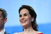 "Michelle Dockery poses with the Variety Icon Award at the Launch of the Official Competition and ""The Truth About The Harry Quebert Affair"" screening during the 1st Cannes International Series Festival at Palais des Festivals on April 7, 2018 in Cannes, France."