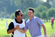 Justin Rose of England is congratulated by his caddie, Mark Fulcher after beating fellow countryman Lee Westwood to win the Turkish Airlines World Golf Final final Day at Antalya GC on October 12, 2012 in Antalya, Turkey.