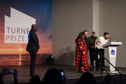 Edward Enninful, Editor-in-Chief of British Vogue looks on as  (L-R) Tai Shani,  Lawrence Abu Hamdan, Helen Cammock and Oscar Murillo celebrate after being announced as the joint winners of Turner Prize 2019 in Margate.
