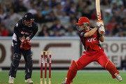 Daniel Harris of the Redbacks bats as wicketkeeper Matthew Wade of the Bushrangers looks on during the Twenty20 Big Bash match between the Victorian Bushrangers and the South Australian Redbacks at Melbourne Cricket Ground on January 28, 2011 in Melbourne, Australia.