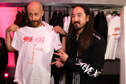 Creative Director of Licenses at Diesel, Andrea Rosso (L) and Steve Aoki pose as Two-time Grammy-Nominated Producer/DJ Steve Aoki Hosts New York City Launch Event for the Diesel On Full Guard 2.5 Touchscreen Smartwatch on October 9, 2018 in New York City.