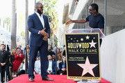 Tyler Perry (L) and Idris Elba attend as Tyler Perry is honored with a Star on the Hollywood Walk of Fame on October 01, 2019 in Hollywood, California.