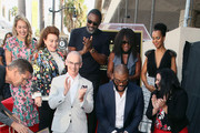 (L-R, front row) Mitch O'Farrell Tyler Perry and Rana Ghadban and (L-R, back row) Sarah Zurell, Donelle Dadigan, Idris Elba, Crystal Fox and Kerry Washington attend Tyler Perry being honored with a Star on the Hollywood Walk of Fame on October 01, 2019 in Hollywood, California.