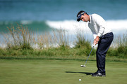 Edoardo Molinari of Italy putts on the tenth green during the first round of the 110th U.S. Open at Pebble Beach Golf Links on June 17, 2010 in Pebble Beach, California.