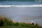 Hunter Mahan hits from the rough near the tenth green during the first round of the 110th U.S. Open at Pebble Beach Golf Links on June 17, 2010 in Pebble Beach, California.
