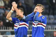 Fabio Quagliarella and Manolo Gabbiadini of UC Sampdoria react at the end of Serie A match between UC Sampdoria and AS Roma at Stadio Luigi Ferraris on April 6, 2019 in Genoa, Italy.