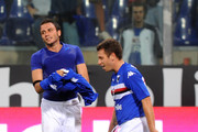 Giampaolo Pazzini and Antonio Cassano of UC Sampdoria celebrate his team's first goal scored by Giampaolo Pazzini during the Serie A match between UC Sampdoria and FC Inter Milan at Stadio Luigi Ferraris on September 26, 2009 in Genoa, Italy.