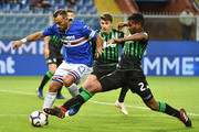 Fabio Quagliarella of Sampdoria stopped from Marlon of Sassuolo during the Serie A match between UC Sampdoria and US Sassuolo at Stadio Luigi Ferraris on October 22, 2018 in Genoa, Italy.