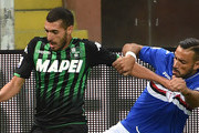 Mehdi Bourabia of Sassuolo and Fabio Quagliarella of Sampdoria battle for the ball during the Serie A match between UC Sampdoria and US Sassuolo at Stadio Luigi Ferraris on October 22, 2018 in Genoa, Italy.