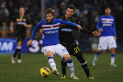 Jonathan Rossini (L) of UC Sampdoria is challenged by Andrea Lazzari of Udinese Calcio during the Serie A match between UC Sampdoria and Udinese Calcio at Stadio Luigi Ferraris on December 10, 2012 in Genoa, Italy.
