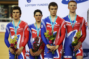(L-R) The Great Britain team of Geraint Thomas, Peter Kennaugh, Steven Burke and Ed Clancy received the silver medal in the Men's Team Pursuit during the UCI Track Cycling World Cup - LOCOG Test Event for London 2012 at the Olympic Velodrome on February 19, 2012 in London, England.