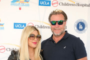 "Tori Spelling (L) and Dean McDermott attend UCLA Mattel Children's Hospital's 20th Annual ""Party on the Pier"" at Pacific Park – Santa Monica Pier on November 03, 2019 in Santa Monica, California."