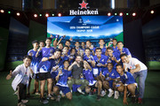 Heinekenn Ambassador Ruud Van Nistelrooy, center, poses for a photograph with Cambodian football players during the UEFA Champions League Trophy Tour presented by Heinekenn on April 3, 2017 in Phnom Penh, Cambodia.
