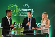 Host Anna Kraft (R) interviews Guido Streichsbier (C), manager of Germany U19s and Benjamin Henrichs (L) of Germany during the UEFA Under19 Championship Finals Draw on April 12, 2016 in Stuttgart, Germany.