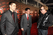(L-R) Mixed martial arts fighters Carlos Condit, Dominick Cruz and actor Mickey Rourke attend UFC on Fox:  Live Heavyweight Championship at the Honda Center on November 12, 2011 in Anaheim, California.