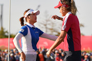 So Yeon Ryu of South Korea and Lexi Thompson of the United States embrace on the 18th green after the Singles match against on day four of the UL International Crown at Jack Nicklaus Golf Club on October 7, 2018 in Incheon, South Korea.