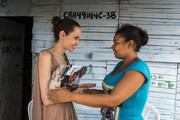 (EDITORIAL USE ONLY) In this handout image provided by United Nations High Commission for Refugees, UNHCR Special Envoy Angelina Jolie speaks with Yoryanis Ojeda, 35, on June 7, 2019 in Riohacha, Colombia. Ojeda is a former Colombian refugee who returned from Venezuela when she could no longer get food and medicine for her children. Jolie visited her at home in Brisas del Norte, an informal settlement that is inhabited by returning refugees as well as Venezuelans escaping a political and economic crisis back home. Over 4 million Venezuelans are now living in exile, with Colombia taking in the greatest share, even as it seeks to implement a peace deal ending five decades of conflict inside its own borders. Ojeda was granted asylum in Venezuela in 2010, with assistance from UNHCR, after being threatened by paramilitary groups in Colombia.