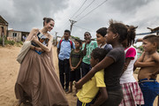 (EDITORIAL USE ONLY) In this handout image provided by United Nations High Commission for Refugees, UNHCR Special Envoy Angelina Jolie speaks with children in Riohacha, Colombia, on June 7, 2019. Jolie visited the children, who had fled Venezuela, in Brisas del Norte, an informal settlement inhabited by Colombian refugees who have returned to their country as well as Venezuelans escaping a political and economic crisis back home. Over 4 million Venezuelans are now living in exile, with Colombia taking in the greatest share, even as it seeks to implement a peace deal ending five decades of conflict inside its own borders.
